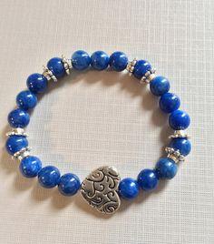 Stretchy bracelets with silver filigree by DesignsByMargarita, $14.00