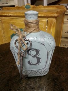 Floor 2 Ceiling Designs in North Carolina painted this recycled Crown liquor bottle using Voyage and Cannonball, both from the Ellis Collection.  Facebook Friday #3 — American Paint Company