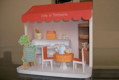 Cafe & Patisserie Paper Model Diorama - by Paper Museum      Model Assembled and Photo by Fletcherjcm    A doll house paper model diorama of a Cafe & Bakery in 1/12 scale, by Japanese website Paper Museum.    Find the link to download this cool free paper model at Papermau.