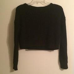 Cropped black Topshop sweater Black cropped cable knit sweater.  I have long arms so the sleeves are like 3/4 length on me. Topshop Sweaters Crew & Scoop Necks