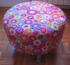 Crochet slip covered IKEA ottoman. Sorry, just a pic, no DIY.