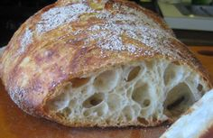 No-Knead Bread! The no-knead method was discovered by baker Jim Lahey who discovered that patient bakers can simulate the gluten-enhancing effect of kneading by simply making a loser (more wattery) dough, using very little yeast, and allowing time to do the work. By allowing the dough to ferment over the course of 12-18 hours, the gluten molecules get stretched out and aligned much in the same way that they do during the course of kneading.    This lazy but patient method, gained instant popularity when New York Times food writer Mark Bittman wrote about Lahey's method in his column, The Minimalist. Since then, the no-knead method has developed a cult following among home bakers.