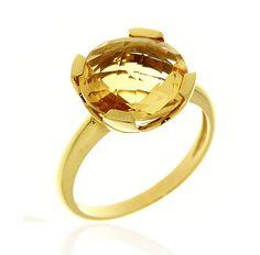 MILANO 14 Ref: 37976 Sortija realizada en oro amarillo. Un citrino, engastado por cuatro garras planas, es el centro de esta pieza.