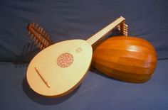 The lute is a fretted, plucked-string instrument with a pear-shaped body, a flat soundboard featuring an ornate rosette, and a peg box at nearly a right angle to the neck.  Its gut strings are usually in pairs, or courses.  The ancestor of the lute is the Arabic 'ud, introduced into Spain by the Moors beginning in 711 A.D.
