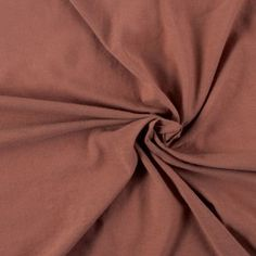 A tissue-weight jersey in an attractive clay color. Perfect for t-shirts and tops.