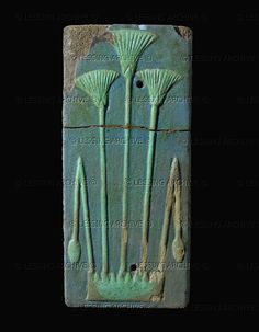 *FAIENCE TILE: from the palace of Seti II (19th dynasty, 1294-1279 BCE).The stylized sheaf of papyrus is the determinative (pictograph) for the name of Lower Egypt.