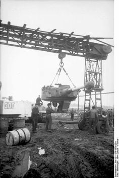 Servicing a Tiger 1 turret required the 'Strobkran' 16 ton collapsable 16 ton overhead crane to get the job done. Photo Repair, Military Records, Ww2 Pictures, Tiger Ii, Ww2 History, Tiger Tank, Military Diorama, Chenille, Panzer