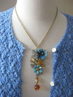 Vintage Jewelry Assemblage Pansy Flower Garden Necklace OOAK Cluster Collage Necklace This Gorgeous Floral Garden is an array of Vintage Jewelry that includes: blue enamel flowers, amber topaz…MoreMore #VintageJewelry