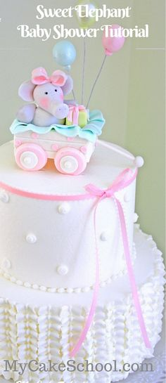 CUTE Elephant and Wagon Cake Topper Tutorial by My Cake School! Learn a beautiful ruffled buttercream technique also! A perfect design for baby shower cakes and young birthdays!