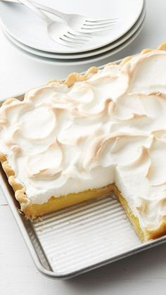 Lemon Meringue Slab Pie - This lemon meringue slab pie is perfect for serving a crowd. Lemon desserts are popular and this pie is no exception—it's great for potlucks and spring gatherings.