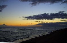 Black Sands Beach by Dennis Begnoche - Photo taken of black sands beach Kauai. Click on the image to enlarge.