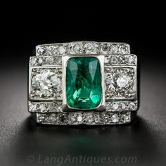 2.38 Carat Emerald and Diamond Art Deco Ring. A bold and beautiful statement in a late-Art Deco cocktail ring. A rich, vibrant green, elongated Colombian emerald, weighing 2.38 carats, joins forces with a pair of sparkling European-cut diamonds in this sizable and substantial (yet comfortable) architecturally inspired platinum ring - circa 1930s.
