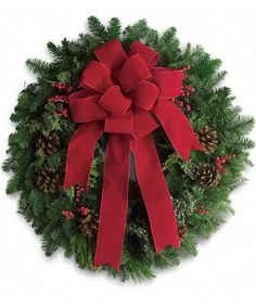 Our Fresh Evergreen Wreath Is Adorned With A Traditional Red Velvet Bow For A Classic Christmas