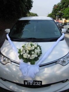 Decoration on car  ~ By: Elegant Scent http://www.wedding.com.my/category-florist-and-decorations/7