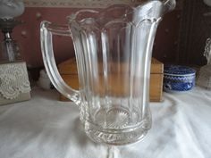Pressed Glass Scalloped Edge Juice Water Pitcher by TammysFindings on Etsy https://www.etsy.com/listing/177577260/pressed-glass-scalloped-edge-juice-water