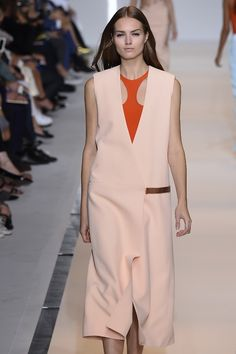 Cut out spaces and bold tangerine colours at the @Mugler #SS15 show #PFW