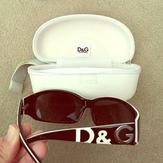 Dolce & Gabbana D&G black & white sunglasses Authentic Dolce & Gabbana black sunglasses with D&G in white and silver on the sides. In good condition but there is a scratch on the left lense. Still lots of life left in them! Will come with original case. No trades. Dolce & Gabbana Other