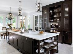 Marble and dark cabinet kitchen.