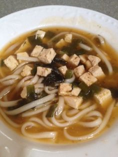 Japanese Miso Soup 1 bunch of Organic Green Onions 1/2 Package of Firm Organic Tofu, diced in small cubes 3 cups Organic Vegetable Broth 1 Package of Organic Soba Noodles 1/2 cup Organic kale 1 sheet of Toasted Seaweed 1 tbsp. miso paste