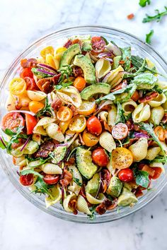 This easy, creamy BLT pasta salad recipe is made healthy with tomatoes, arugula, and avocado and bacon dressed with a healthier Greek yogurt Ranch dressing.