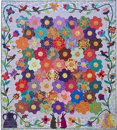 Honey Flow quilt by Kerry Stitch Designs.  Kaffe Fassett fabrics. There are 59 Hexie Flowers  appliqued onto a dotted fabric