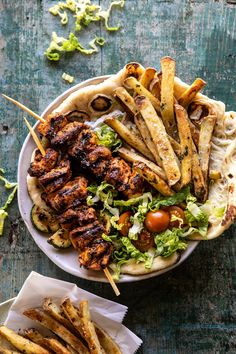 """Chicken Souvlaki Bowls with Garlicky Fries. The Greek-inspired """"street food"""" bowl that you need in your life this week –> grilled Greek marinated chicken skewers, served bowl style with gr… Greek Marinated Chicken, Lemon Chicken, Greek Chicken Souvlaki, Roasted Chicken, Fried Chicken, Half Baked Harvest, Cooking Recipes, Healthy Recipes, Greek Recipes"""