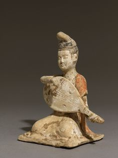 Figure of a mandolin player China, late 7th century - early 8th century AD