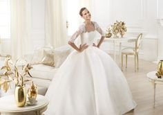 Pronovias Leslie Costura 2014 Comments:  I absolutely adore the ball gown with the lace sleeves and natural, pleated waist