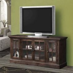 The Nora TV stand versatility and style will blend masterfully in your living room area. The storage feature offers plenty of space to keep your entertainment components: four glass doors with one shelf inside. Carefully constructed from selected wood and veneers in Dark Lager Finish which gives this piece an elegant and sleek appeal.
