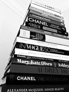 I love the idea of a black and white bookshelf in my future office with bright, colorful art.