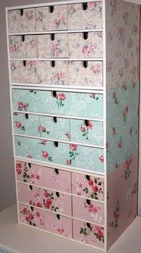 Patty of River Bend Ranch Studio wallpapered these Ikea storage units with pretty vintage wallpaper.