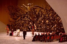 The Pope's Audience Hall Looks Like A Final Fantasy Boss Fight. Photograph by Andreas Solar/AFP/Getty of a meeting with Pope Francis at the Paul VI Audience Hall at the Vatican. The sculpture is La Resurrezione by Pericle Fazzini. http://screenburn.kotaku.com/the-popes-audience-hall-looks-like-a-final-fantasy-boss-1568714627/+lukeplunkett