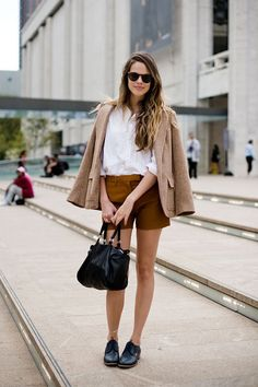 Shop this look for $315:  http://lookastic.com/women/looks/shorts-and-button-down-shirt-and-tote-bag-and-derby-shoes-and-blazer/2409  — Tobacco Shorts  — White Button Down Shirt  — Black Leather Tote Bag  — Black Leather Derby Shoes  — Tan Tweed Blazer