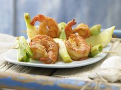 A delicious marinade flavors shrimp that are skewered with scallions before being cooked on the grill.