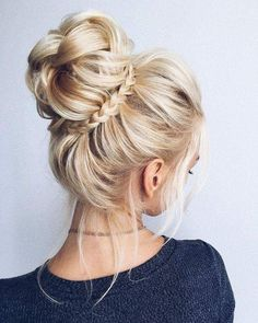 Bun or top knot with small braid wrap.