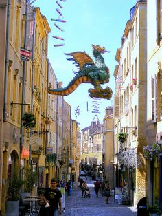 The Graoully is a legendary monster of Metz, flying here above an old shopping street , rue Taison - Metz - France . Lorraine, Metz France, Legendary Monsters, Alsace, Ardennes, Shopping Street, Paris Love, Medieval Town, France Travel