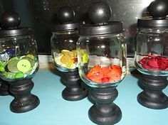 Baby food jars. Change color to red fill with skittles. Cute party favor.