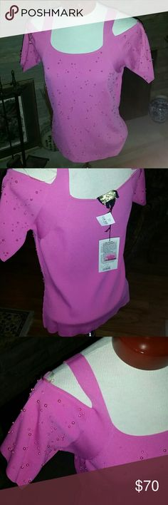 Gorgeous Hot Pink Size XL New with tags! Amazing top beaded front and sleeves. Shoulder cut outs hot style now. New with tags. Size XL. Rayon /Nylon stretch. Christine Phillipe Tops Blouses