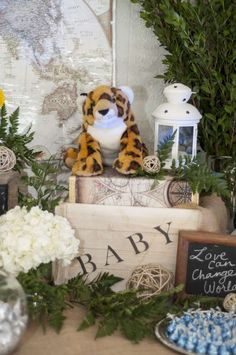 Wild decor at a travel safari baby shower party! See more party planning ideas at CatchMyParty.com!