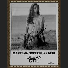 """Marzena Godecki is a Polish-born Australian actress. She is best known for her starring role as Neri in Disney's Ocean Girl.""""Ocean Girl"""" was filmed in some astoundingly beautiful locations including Australia's Great Barrier Reef and rain forests in Queensland. This delightful Disney TV series ran from 1994 to '97.Ocean Girl was about a young girl who lived on a deserted island. She portrayed an alien/mermaid who befriended a large whale and watched over her friends.Marzena never pursued…"""