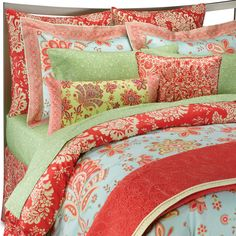 This is Amy Butler bedding, with blue being the main color. Mint, red-orange, and butter-yellow round out the scheme. Warm and cool working harmoniously; the sum is much greater than its parts.