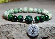 Earthy and grounding Gemstone Bracelet made with 8mm Tree Agate and Green Tiger Eye with a Tree of Life Charm. Tiger Eye Properties: Helps to keep you focused, centered and grounded. It is also benefi