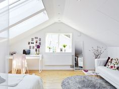 Clean white small attic apartment with vibrant pops of color #whitebedroom #homeideas