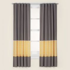 Great idea by adding a color panel to store bought drapes you can add your own color combination plus make them super long to create more drama.