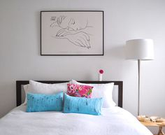 Image above: The picture above the bed is a Picasso print of a sleeping woman . . . hopefully conjuring up feelings of sleep at night! We really like the serenity, simplicity and uncluttered feeling of white for the bed linens, white walls and the white lampshade.