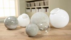 Make these inexpensive and fun concrete ball accents for your garden using surprising tools -- either a glass globe for a light fixture or a glass Christmas ornament. Watch and learn how./