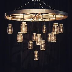 00 Introducing our Wagon Wheel chandelier featuring dangling edison bulbs and mason jars. Introducing our Wagon Wheel chandelier featuring dangling edison bulbs and mason jars. Edison Bulb Chandelier, Mason Jar Chandelier, Rustic Chandelier, Chandelier Lighting, Chandeliers, Edison Bulbs, Wagon Wheel Chandelier Diy, Wagon Wheel Light, Wagon Wheel Decor