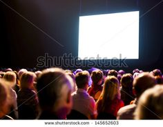 Crowd Audience In Dark Looking At Bright Screen Stock - bright screen that we can overlay text or images; possibly at diner gala timeframe
