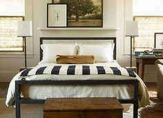 navy and mustard bedroom, white bedspread