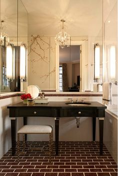 An Elegant Bathroom Filled with Unique Touches, Such as the Unique Vanity and Tilework
